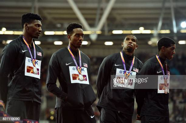 Silver medallist US athlete Wilbert London III US athlete Gil Roberts US athlete Michael Cherry and US athlete Fred Kerley pose on the podium during...