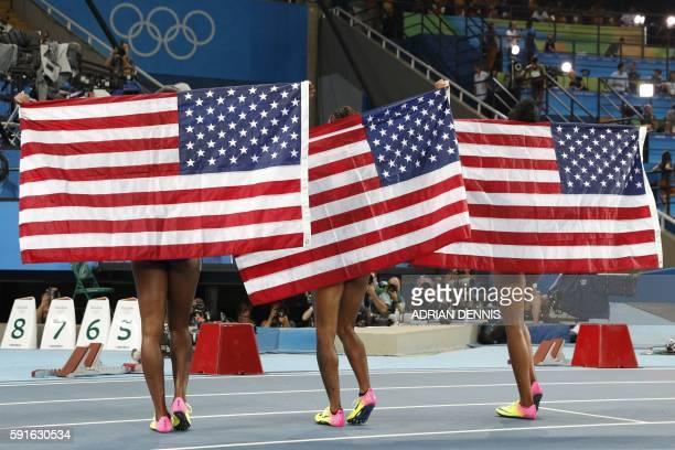 TOPSHOT Silver medallist USA's Nia Ali gold medallist USA's Brianna Rollins and bronze medallist USA's Kristi Castlin celebrate after the Women's...