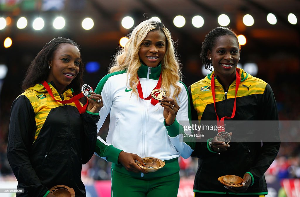 Silver medallist Veronica Campbell-Brown of Jamaica , Gold medallist Blessing Okagbare of Nigeria and bronze medallist Kerron Stewart of Jamaica pose on the podium during the medal ceremony for the Women's 100 metres at Hampden Park during day six of the Glasgow 2014 Commonwealth Games on July 29, 2014 in Glasgow, United Kingdom.
