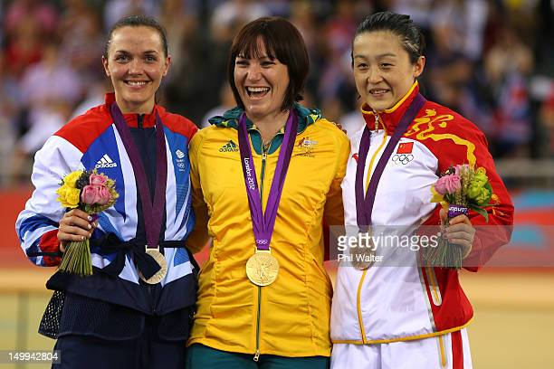Silver medallist Victoria Pendleton of Great Britain Gold medallist Anna Meares and Bronze medallist Shuang Guo of China celebrate during the medal...