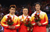 Silver medallist Wang Hao of China gold medallist Ma Lin of China and bronze medallist Wang Liqin of China celebrate with their medals after the Mens...