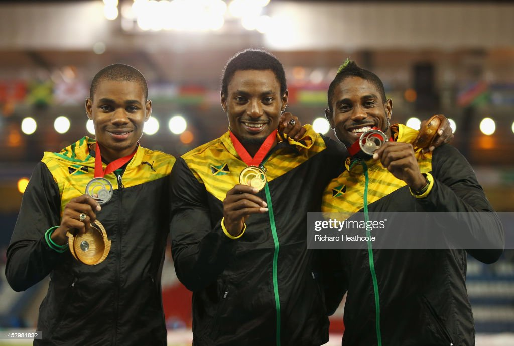Silver medallist <a gi-track='captionPersonalityLinkClicked' href=/galleries/search?phrase=Warren+Weir&family=editorial&specificpeople=9482526 ng-click='$event.stopPropagation()'>Warren Weir</a> of Jamaica, gold medallist <a gi-track='captionPersonalityLinkClicked' href=/galleries/search?phrase=Rasheed+Dwyer&family=editorial&specificpeople=7243414 ng-click='$event.stopPropagation()'>Rasheed Dwyer</a> of Jamaica and bronze medallist <a gi-track='captionPersonalityLinkClicked' href=/galleries/search?phrase=Jason+Livermore&family=editorial&specificpeople=7165850 ng-click='$event.stopPropagation()'>Jason Livermore</a> of Jamaica pose on the podium during the medal ceremony for the Men's 200 metres at Hampden Park during day eight of the Glasgow 2014 Commonwealth Games on July 31, 2014 in Glasgow, United Kingdom.