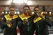Silver medallist Warren Weir of Jamaica gold medallist Rasheed Dwyer of Jamaica and bronze medallist Jason Livermore of Jamaica pose on the podium...