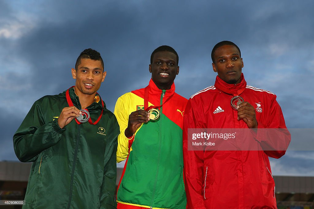 Silver medallist Wayde van Niekerk of South Africa, gold medallist <a gi-track='captionPersonalityLinkClicked' href=/galleries/search?phrase=Kirani+James&family=editorial&specificpeople=5432961 ng-click='$event.stopPropagation()'>Kirani James</a> of Grenada and bronze medallist <a gi-track='captionPersonalityLinkClicked' href=/galleries/search?phrase=Lalonde+Gordon&family=editorial&specificpeople=9001879 ng-click='$event.stopPropagation()'>Lalonde Gordon</a> of Trinidad and Tobago pose on the podium during the medal ceremony for the Men's 400 metres at Hampden Park during day seven of the Glasgow 2014 Commonwealth Games on July 30, 2014 in Glasgow, United Kingdom.