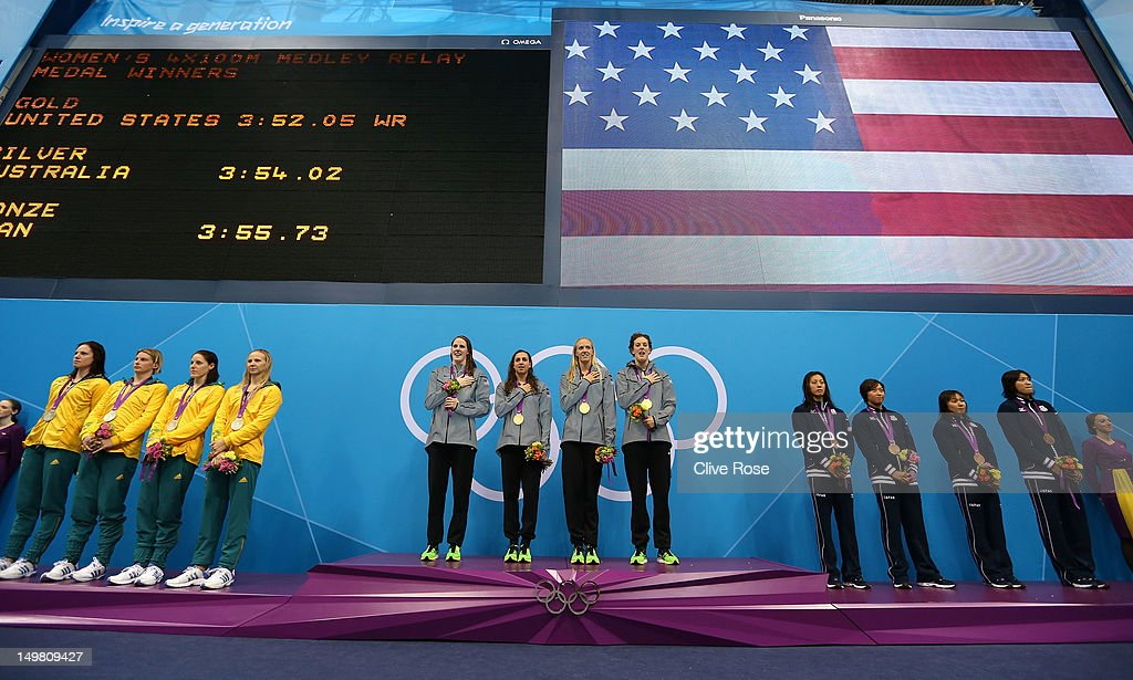 Silver medallists Australia, gold medallists the United States, and bronze medallists Japan pose on the podium during the medal ceremony for the Women's 4x100m medley Relay Final on Day 8 of the London 2012 Olympic Games at the Aquatics Centre on August 4, 2012 in London, England.