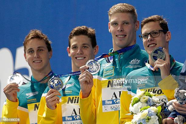 Silver medallists Cameron McEvoy Jayden Robert Hadler Jake Packard and Mitch Larkin of Australia pose during the medal ceremony for the Men's 4x100m...