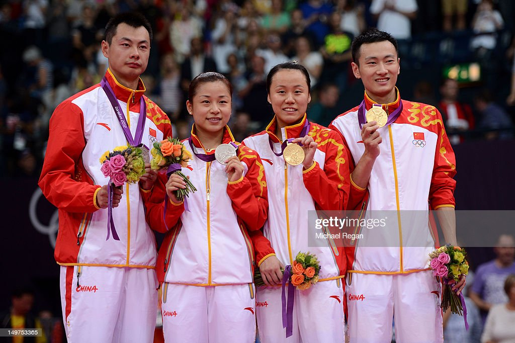 Silver medallists Chen Xu and Jin Ma of China and Gold medallists Nan Zhang and Yunlei Zhao of China hold their medals during the Mixed Doubles Badminton medal ceremony on Day 7 of the London 2012 Olympic Games at Wembley Arena on August 3, 2012 in London, England.