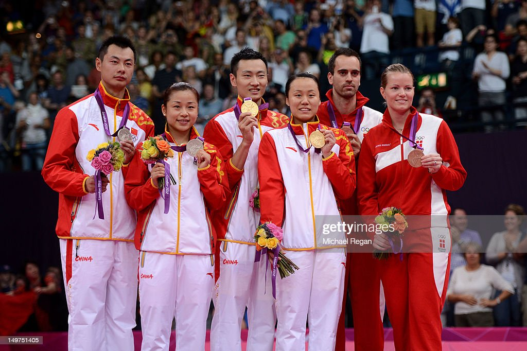 Silver medallists Chen Xu and Jin Ma of China, Gold medallists Nan Zhang and Yunlei Zhao of China and Bronze medallists Joachim Fischer and Christinna Pedersen of Denmark in the Mixed Doubles Badminton medal ceremony on Day 7 of the London 2012 Olympic Games at Wembley Arena on August 3, 2012 in London, England.