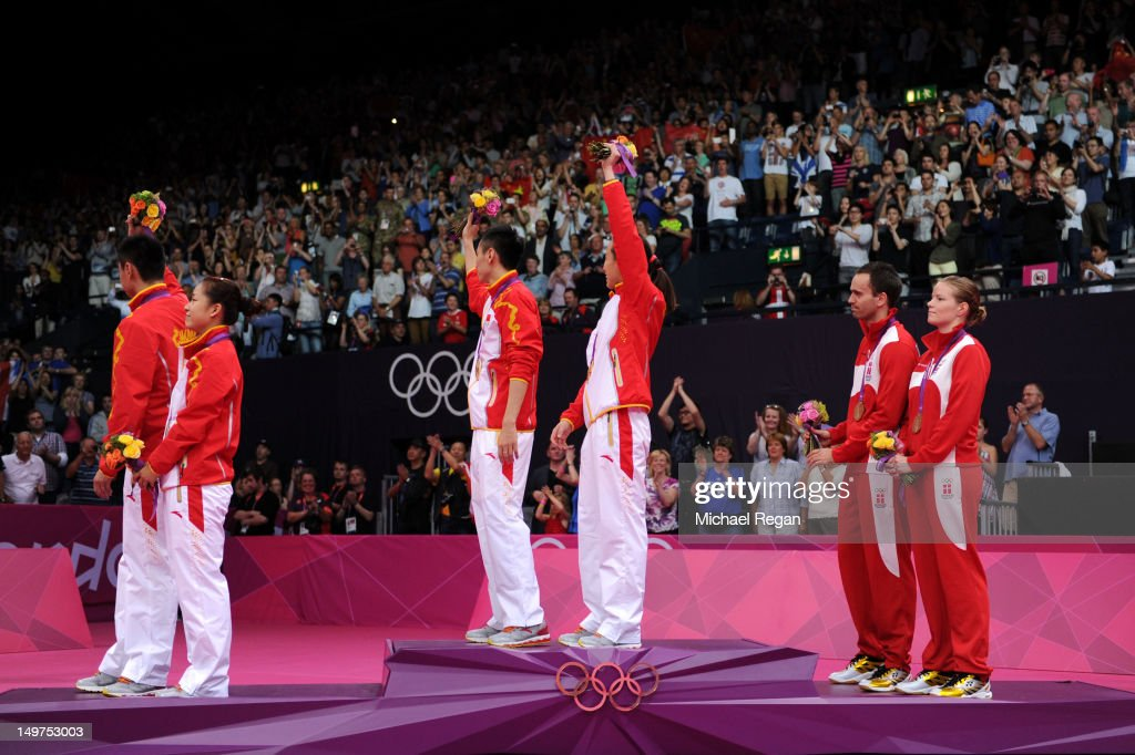 Silver medallists Chen Xu and Jin Ma of China, Gold medallists Nan Zhang and Yunlei Zhao of China and Bronze medallists Joachim Fischer and <a gi-track='captionPersonalityLinkClicked' href=/galleries/search?phrase=Christinna+Pedersen&family=editorial&specificpeople=5933396 ng-click='$event.stopPropagation()'>Christinna Pedersen</a> of Denmark in the Mixed Doubles Badminton medal ceremony on Day 7 of the London 2012 Olympic Games at Wembley Arena on August 3, 2012 in London, England.
