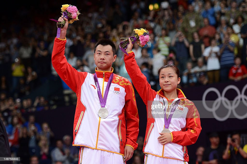 Silver medallists Chen Xu and Jin Ma of China hold their medals in the Mixed Doubles Badminton medal ceremony on Day 7 of the London 2012 Olympic Games at Wembley Arena on August 3, 2012 in London, England.