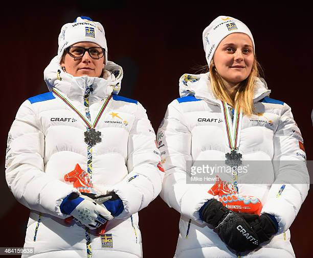 Silver medallists Ida Ingemarsdotter and Stina Nilsson of Sweden pose during the medal ceremony for the Women's CrossCountry Team Sprint Final during...