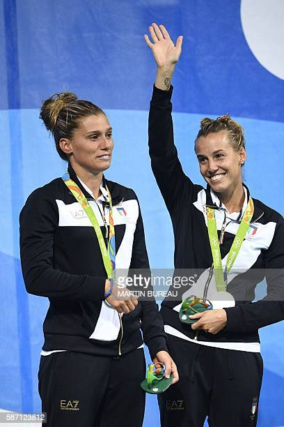 Silver medallists Italy's Tania Cagnotto and Francesca Dallape pose during the podium ceremony of the Women's Synchronized 3m Springboard final event...