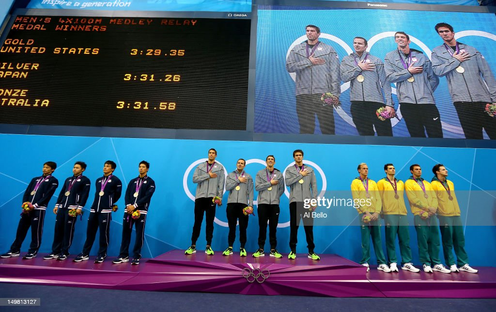 Silver medallists Japan, gold medallists the United States and bronze medallists Australia pose on the podium in the medal ceremony for the Men's 4x100m medley Relay Final on Day 8 of the London 2012 Olympic Games at the Aquatics Centre on August 4, 2012 in London, England.