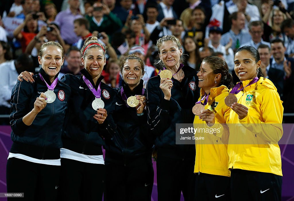 Silver medallists Jennifer Kessy and April Ross of the United States, Gold medallists Misty May-Treanor and Kerri Walsh Jennings, and Bronze medallists Larissa Franca and Juliana Silva of Brazil celebrate on the podium during the medal ceremony for the Women's Beach Volleyball on Day 12 of the London 2012 Olympic Games at the Horse Guard's Parade on August 8, 2012 in London, England.
