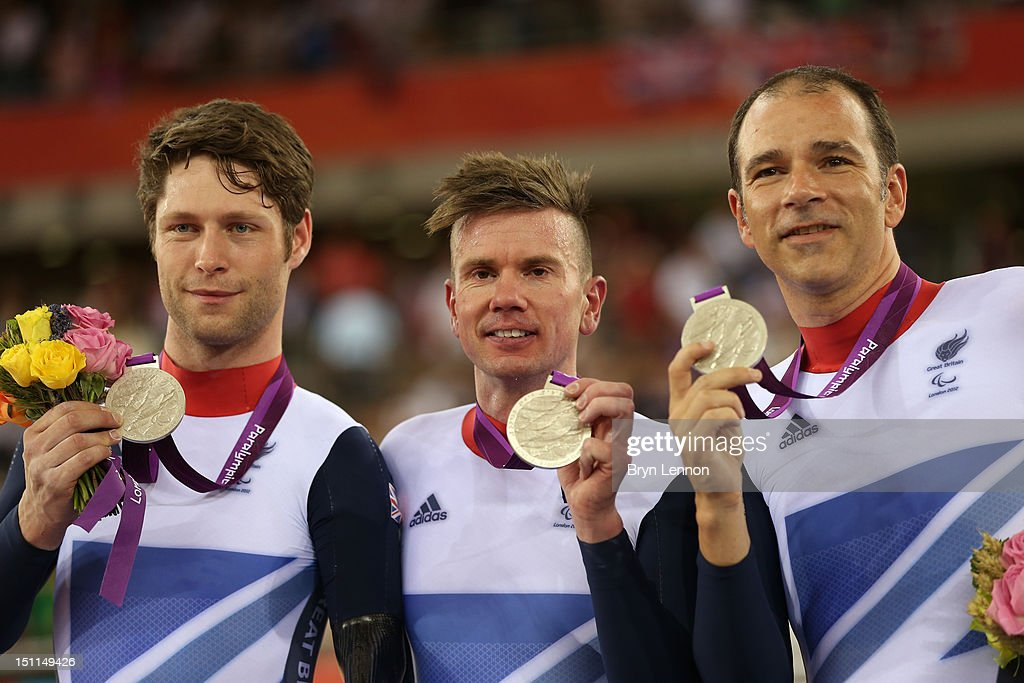 Silver medallists JonAllan Butterworth Richard Waddon and Darren Kenny of Great Britain pose on the podium during the medal ceremony for the Mixed C1...