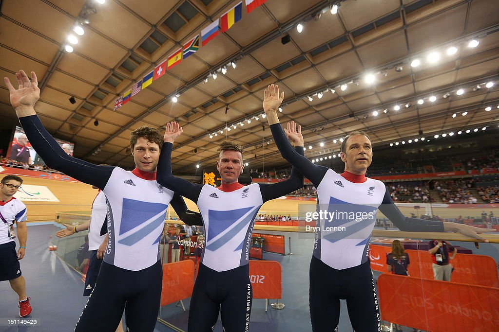 Silver medallists JonAllan Butterworth Richard Waddon and Darren Kenny of Great Britain pose after winning the silver in the Mixed C1 to 5 Cycling...