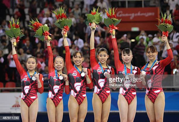 Silver medallists Koko Tsurumi Mai Yamagishi Kyoko Oshima Yuko Shintake Momoko Ozawa and Rie Tanaka of Japan celebrate on the podium at the medal...