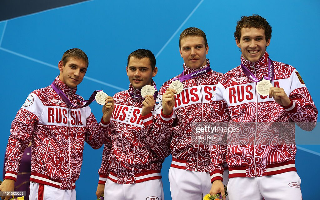 Silver medallists Konstantin Lisenkov, Pavel Poltavtsev, Eduard Samarin and Denis Tarasov of Russia pose on the podium during the medal ceremony for the Men's 4x100m Medley - 34pts final on day 10 of the London 2012 Paralympic Games at Aquatics Centre on September 8, 2012 in London, England.