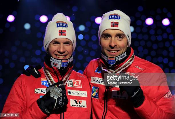 Silver medallists Magnus Krog and Magnus Hovdal Moan of Norway celebrate during the medal ceremony after the Men's Nordic Combined HS130 Ski Jumping...