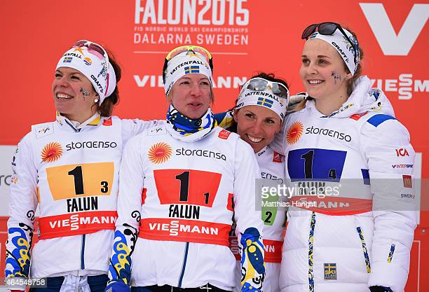 Silver medallists Maria Rydqvist Sofia Bleckur Charlotte Kalla and Stina Nilsson of Sweden pose after the Women's 4 x 5km CrossCountry Relay during...