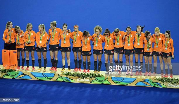 Silver medallists Netherlands' Joyce Sombroek Netherlands' Xan de Waard Netherlands' Kitty van Male Netherlands' Laurien Leurink Netherlands'...
