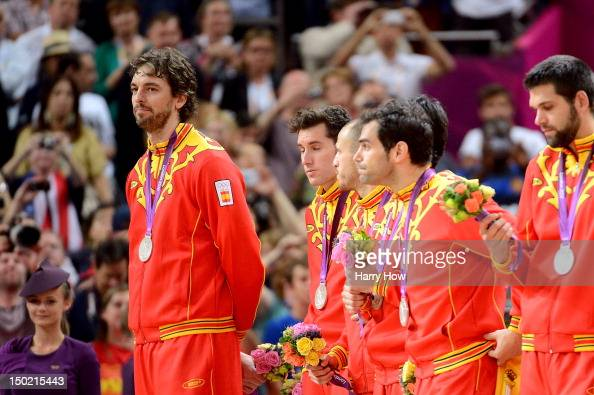Silver medallists Pau Gasol of Spain and team mates pose on the podium during the medal ceremony for the Men's Basketball on Day 16 of the London...