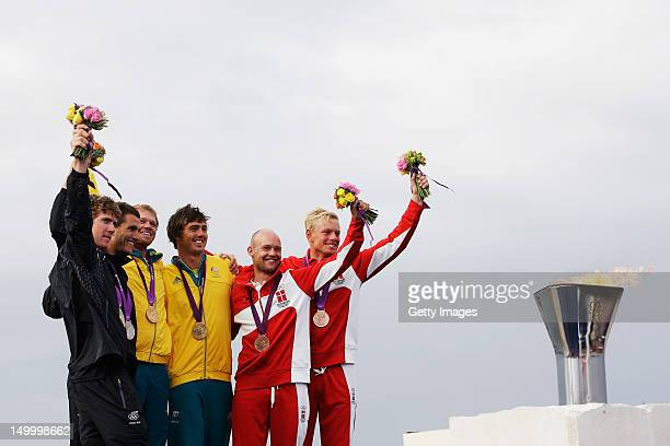 Silver medallists Peter Burling and Blair Tuke of New Zealand gold medallists Nathan Outteridge and Iain Jensen of Australia and bronze medallists...