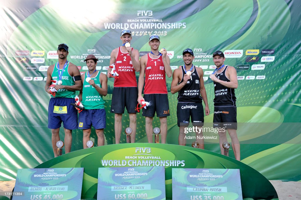 Silver medallists <a gi-track='captionPersonalityLinkClicked' href=/galleries/search?phrase=Ricardo+Alex+Costa+Santos+-+Jogador+de+voleibol+de+praia&family=editorial&specificpeople=2341965 ng-click='$event.stopPropagation()'>Ricardo Alex Costa Santos</a> and Alvaro Morais Filho of Brazil with gold medallists, Alexander Brouwer and Robert Meeuwsen of the Netherlands and bronze medallists, Jonathan Erdmann and Kay Matysik from Germany during the medal ceremony after the men's final match between the Netherlands and Brazil during Day 7 of the FIVB World Championships on July 7, 2013 in Stare Jablonki, Poland.