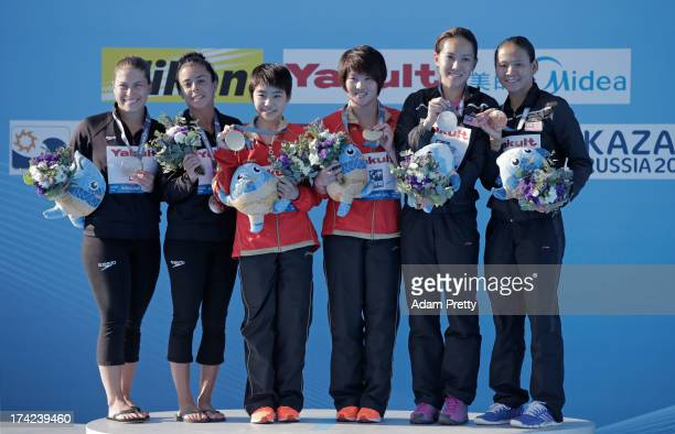 Silver medallists Roseline Filion and Meaghan Benfeito of Canada gold medallists Liu Huixia and Chen Ruolin of China and bronze medallists Leong Mun...