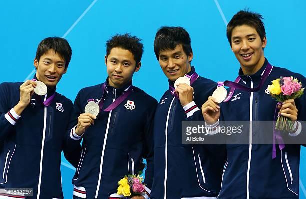 Silver medallists Ryosuke Irie Kosuke Kitajima Takeshi Matsuda and Takuro Fujii of Japan pose on the podium during the medal ceremony for the Men's...