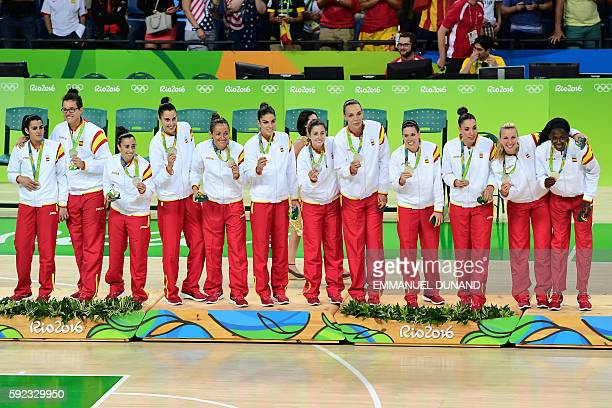 Silver medallists Spain's power forward Laura Nicholls Spain's point guard Leticia Romero Spain's point guard Silvia Dominguez Spain's forward Alba...