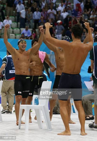 Silver medallists Takuro Fujii Takeshi Matsuda Kosuke Kitajima and Ryosuke Irie of Japan celebrate finishing second in the Men's 4x100m Meldey Relay...