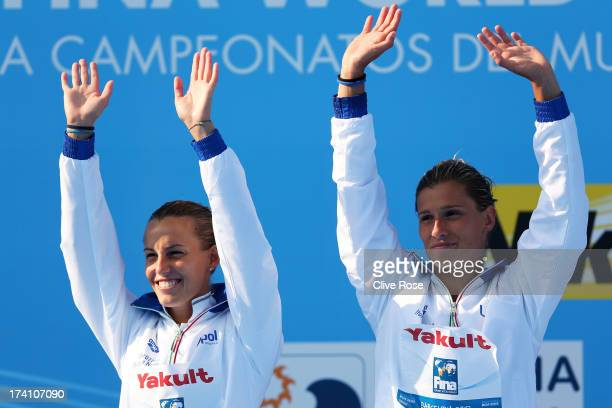 Silver medallists Tania Cagnotto and Francesca Dallape of Italy wave to the fans prior to receiving the medals won in the Women's 3m Springboard...