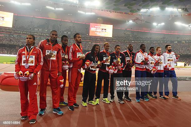 Silver medallists Trinidad and Tobago's Renny Quow Lalonde Gordon Deon Lendore Machel Cedenio gold medallists USA's David Verburg Tony McQuay Bryshon...