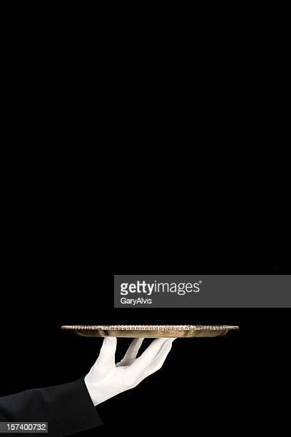Silver Platter held by white gloved hand/isolated on black-vertical