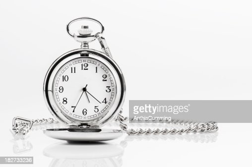 Silver pocket watch and chain on a white background