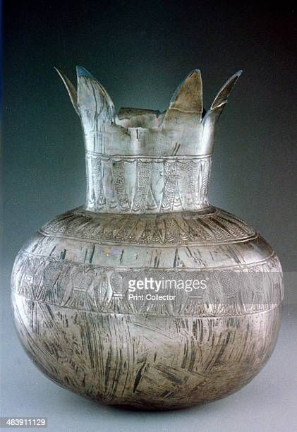 Silver pomegranate vase from Tutankhamun's tomb 14th century BC The tomb of the 18th Dynasty Ancient Egyptian Pharaoh Tutankhamun was discovered in...