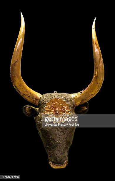Silver rhyton in the shape of a bovine head with gold horns and rosette on the forehead The muzzle which has a pouring hole is gold plated as were...