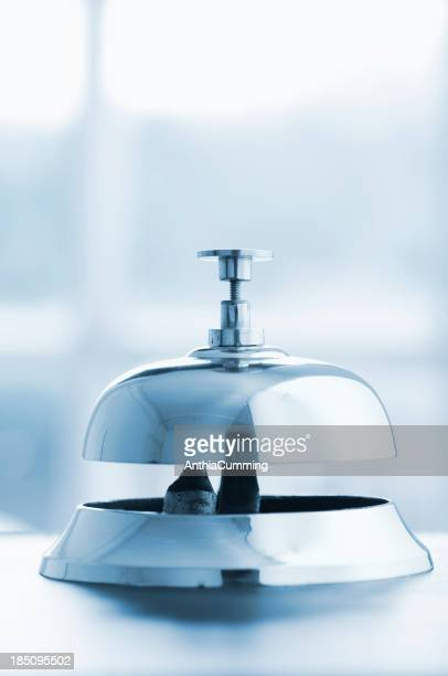 Silver service bell on a desk with copy space above