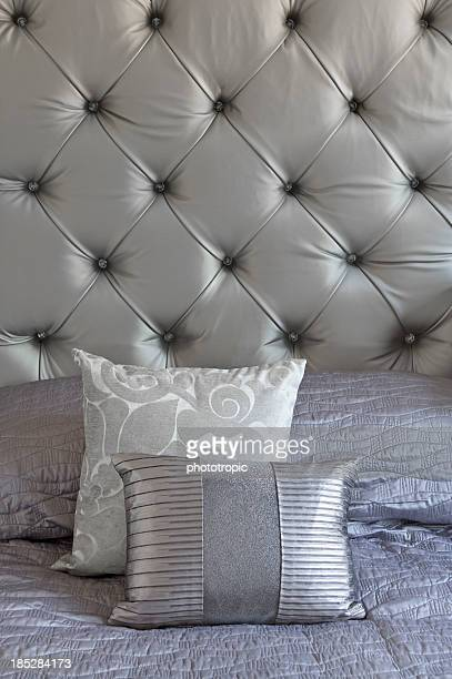 silver silk cushions and headboard