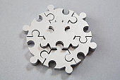 Silver six sides puzzle, central piece raised