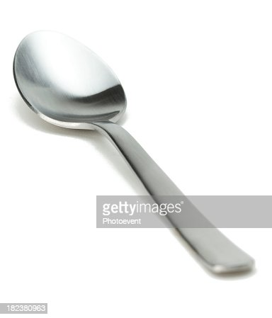 Silver spoon against white background