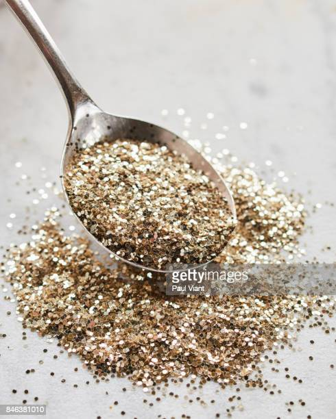 silver spoon and gold glitter