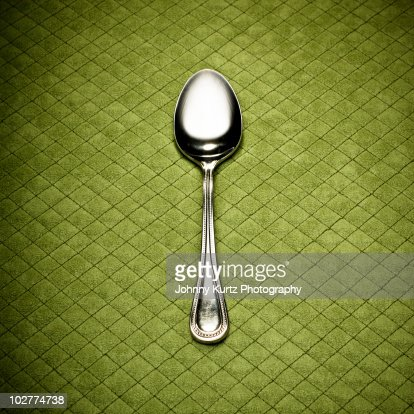 Silver Spoon on Green Diamond Placemat