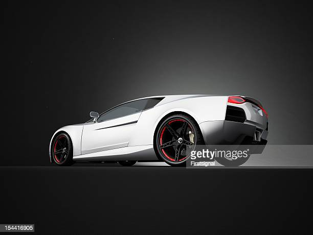 Silver sport car on black studio background