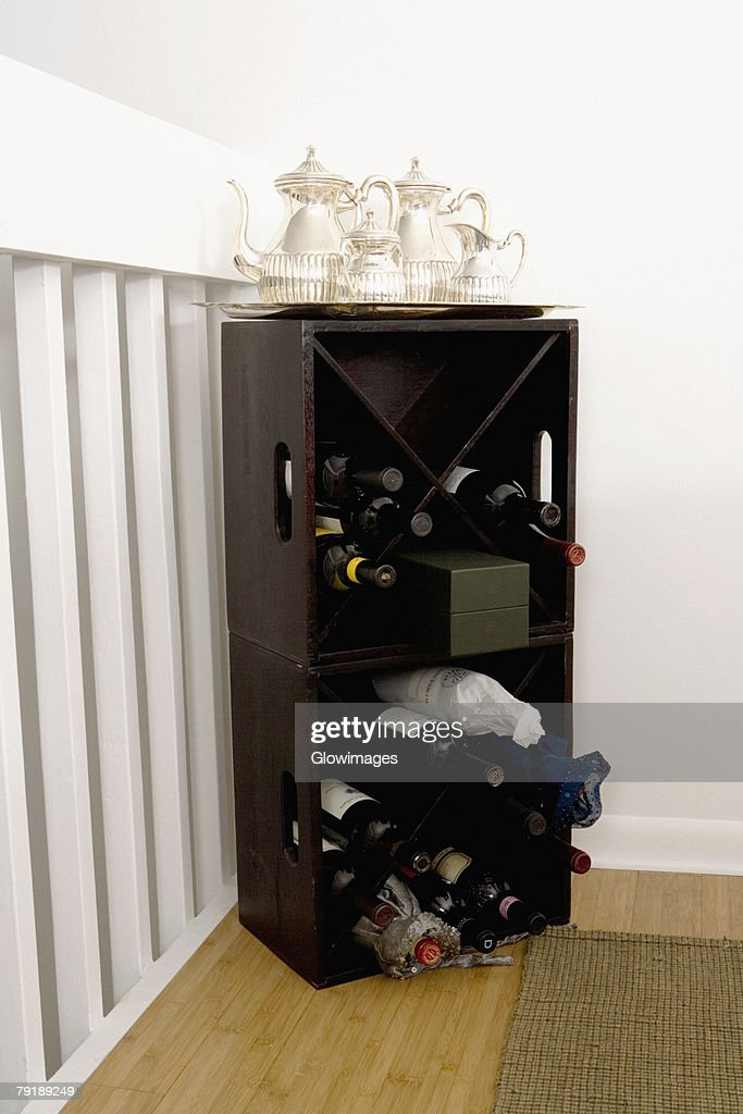 Silver teapots on a wine rack : Stock Photo