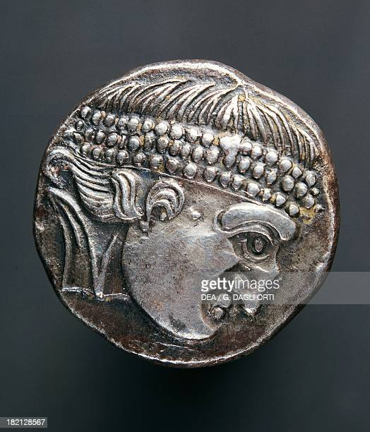 Silver tetradrachm of the Danube Celts profile of a man wearing a diadem recto Celtic coins 1st century BC