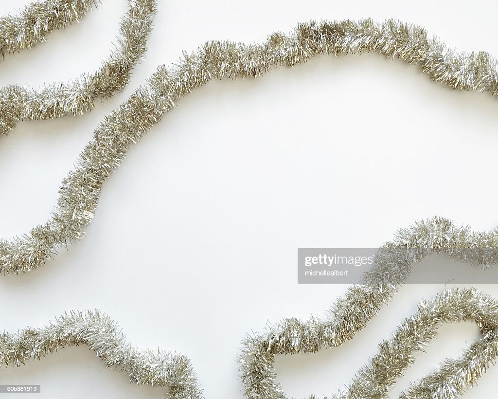 Silver tinsel on a white background