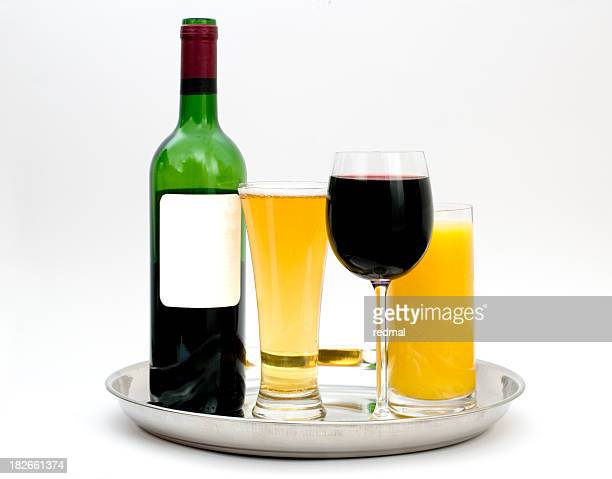 A silver tray of alcoholic drinks on a white background