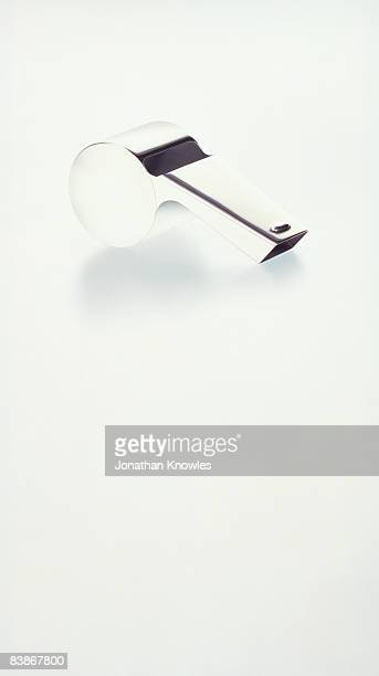 Silver whistle on a white background